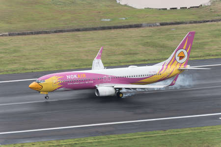 Phuket, Thailand ; September 17,2015 nok airway airplane landing touch runway at phuket airport