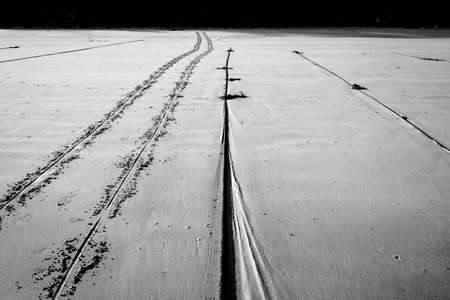 wheel track and rope on beach
