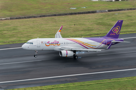 airway: Phuket, Thailand ; September 17,2015  Thai smile airway airplane landingt at phuket airport in rainny day and runway surface damp Editorial