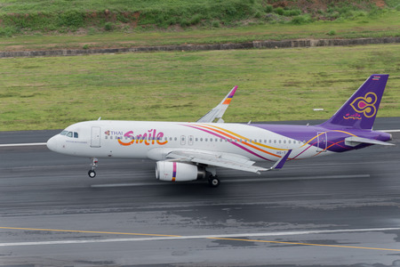 Phuket, Thailand ; September 17,2015  Thai smile airway airplane landingt at phuket airport in rainny day and runway surface damp Sajtókép