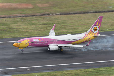 airway: Phuket, Thailand ; September 17,2015 nok airway airplane landing touch runway at phuket airport