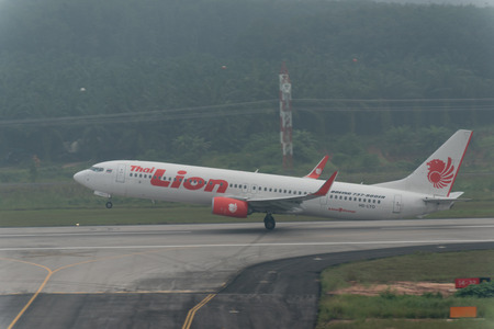 Krabi , Thailand ; October 6,2015. Thai lion air airline take off in haze at Krabi airport late in morning effect from Haze caused by forest fires in indonesia