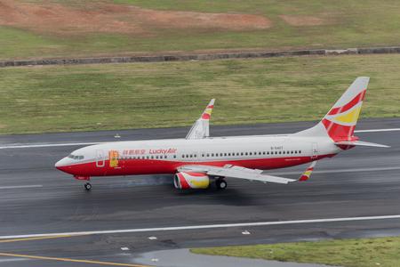 Phuket, Thailand ; September 17,2015  Lucky airway airplane landingt at phuket airport in rainny day and runway surface damp
