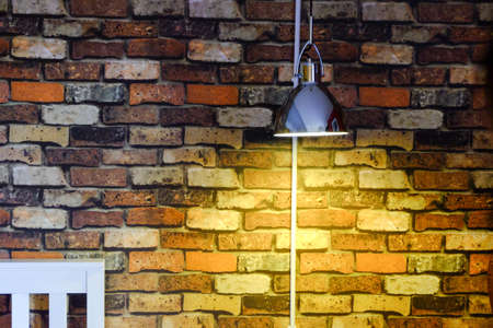 pendant lamp: Light shining gold On Wall Brick.
