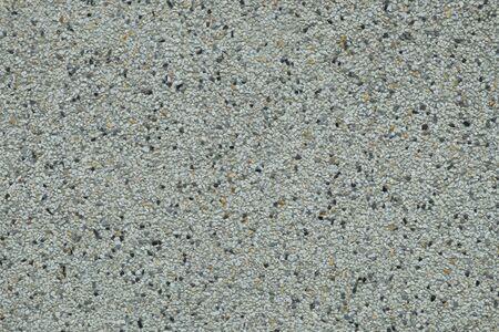 correlate: Small stone in cement floor texture Stock Photo