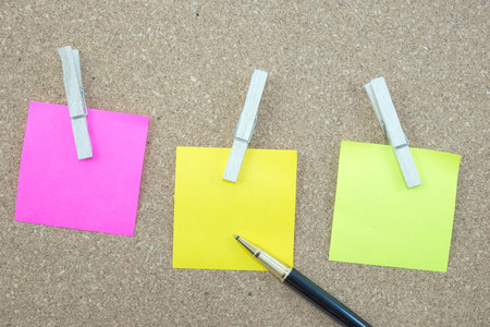 postit: post-it and pen put on plywood Stock Photo