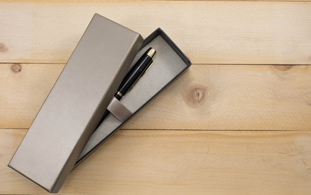 line lines luxury meeting: pen in luxury box on wooden background Stock Photo