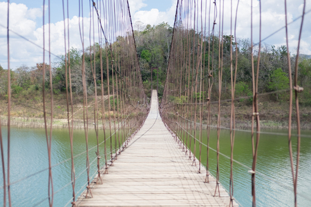 strong suspension bridge stretches through the middle of lake Kaeng Krachan tourist area in Thailand. this image for nature, landscape and holiday concept