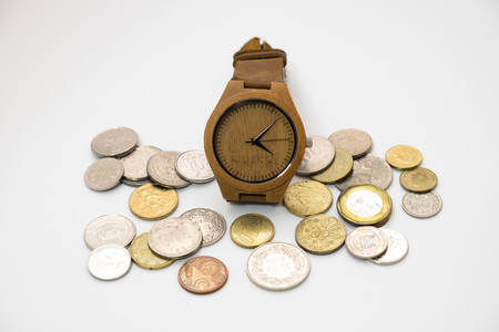 classic wooden watch putting on various sizes coin stack with white background,this image for money saving and retro concept Stock Photo