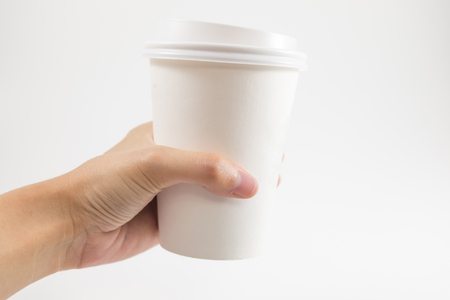 white background hand of bussinessman hold coffee glass with copy space. image for body, food, drink, isolated, cafe, beverage, business concept