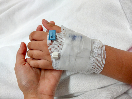 healthcare background hand of woman touching child hand with gauze and resting in hospital room