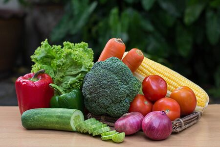 Variety of fresh vegetables on wood table photo
