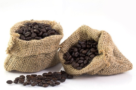 Coffee beans in a sack isolated on white background photo