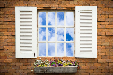 Open Old Window With Flower Basket On Brick  Wall photo
