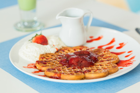 Waffles with Strawberry jam and fresh strawberry photo