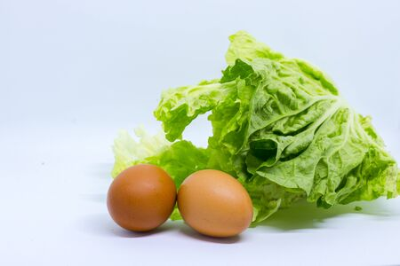 eggs and chinese cabbage on the white background Stock Photo