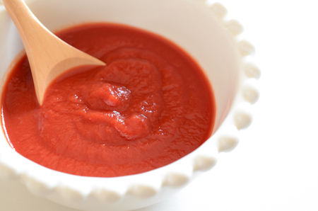 tomato puree: Tomato puree Stock Photo