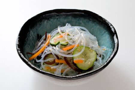 Vinegared gelatin noodles with vegetables Фото со стока