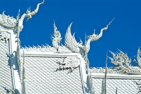 Top part decoration of famous white church in Wat Rong Khun, Chiang Rai, north of Thailand Stock Photo
