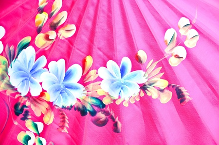 A pink parasol with white and pink and flower decoration. Stock Photo - 9230329
