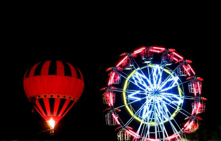 hot air balloon glow at night and ferris wheel Stock Photo - 11311691