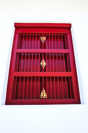 red thai style window on white wall Stock Photo