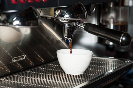 Coffee is pouring a glass of coffee machines