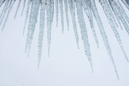 Ice  which  are  hanging  down  from  a  roof Stock Photo