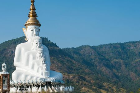 big white Buddha with cloud blue sky in buddhist temple in Thailand