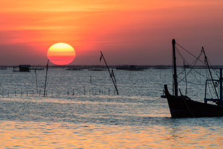 sunset and fishing boat,Thailand Stock Photo