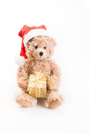 Teddy bear with Christmas hat on a white background Stock Photo