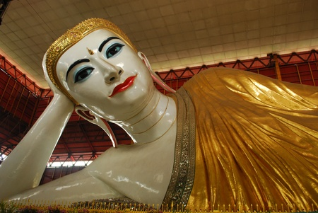 Reclining Buddha at Chaukhtatgyi temple in Yangon, Myanmar photo