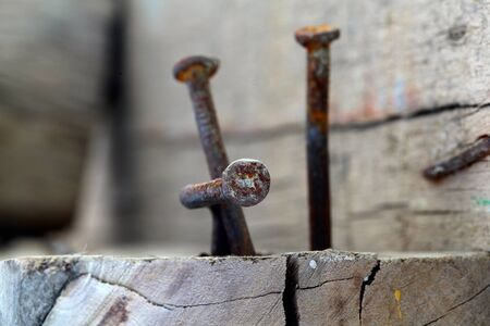 split rail: rusty nails in wood