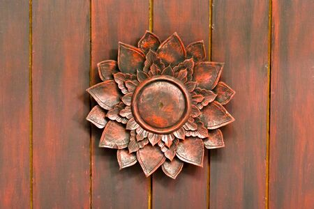 red wooden lotus on church photo