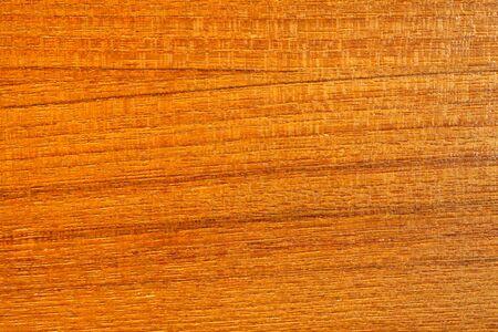 closeup on golden teak wood texture photo