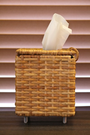 wicker wood tissue box on table photo