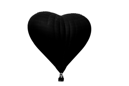 silhouette hot air balloon flying isolated on white background