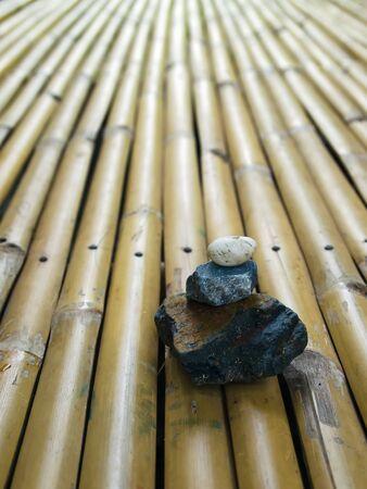 Three Zen Rock on Yellow Bamboo Background photo
