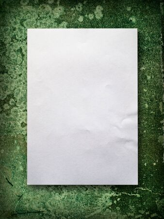 Blank White A4 paper on green old wall background Stock Photo - 7185057