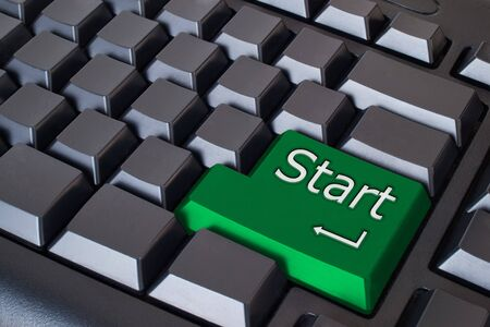 Green start button on Black keyboard  Stock Photo - 7290754