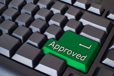 Green Approved button on black keyboard Stock Photo - 7290777