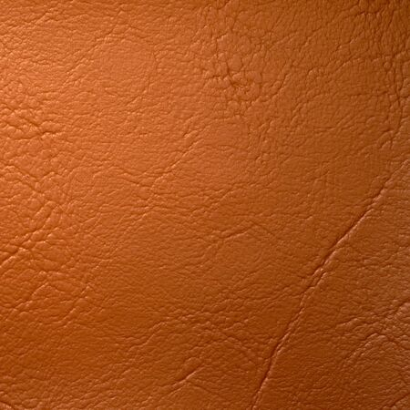 leatherette: texture of orange leatherette for design