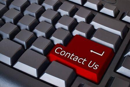 iconos contacto: Red Cont�ctenos Button en teclado negro