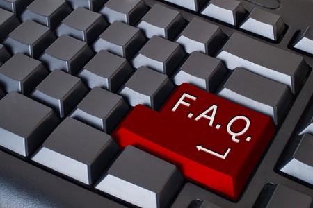 Red FAQ button on black keyboard Stock Photo - 7534826