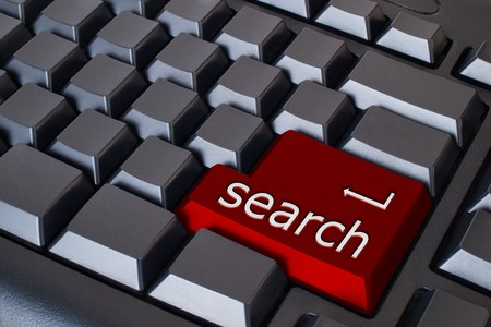 Red search button on black keyboard Stock Photo - 7534831