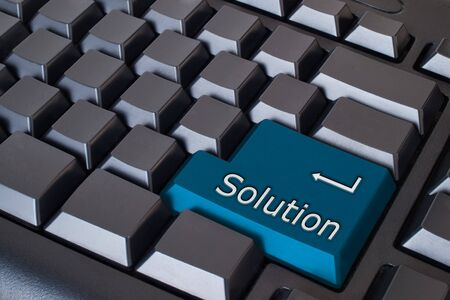 Blue Solution Button on Black Keyboard Stock Photo - 7534835