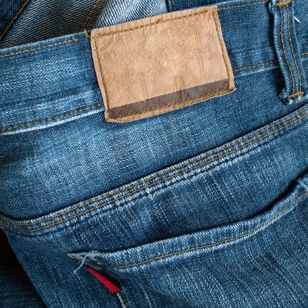 red leather texture: Back of blue jeans with leather label