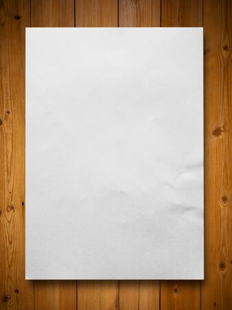 White blank paper on wood background photo
