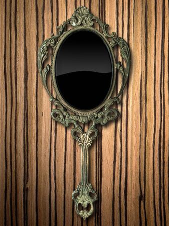 hands in  pocket: ancient hand mirror on zebrano Wood background