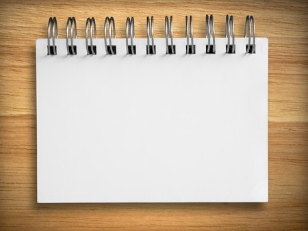 blank white notebook on rubber wood background photo